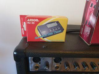 Bajo electrico Storm + amplificador AXL