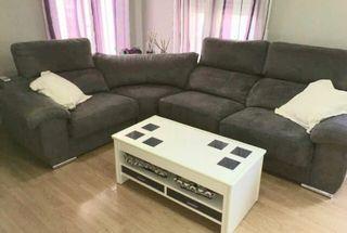 Sofá deslizante con rinconera decorativa