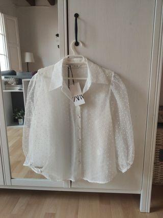 camisa semi transparente blanca