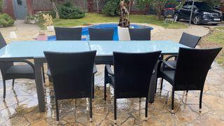 Mesa de cristal extensible con 8 sillas