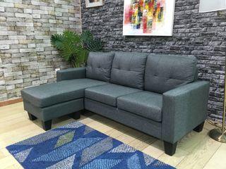 Sofá chaise-longue gris oscuro tela