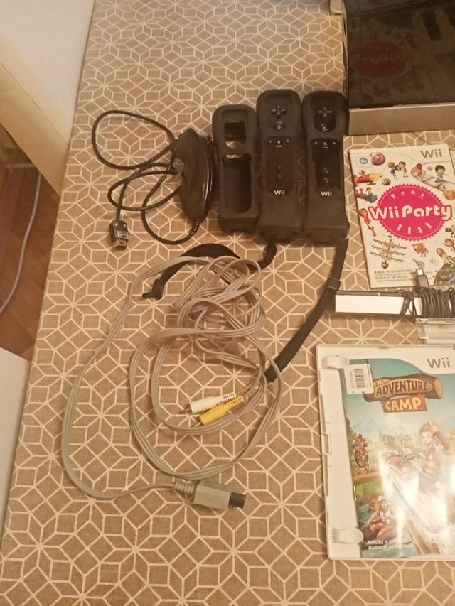 Consola Wii + 2 mandos + 1 jueg