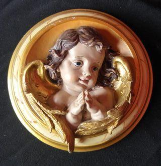 Cuadro con figura de angelito.