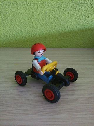 Playmobil niño en triciclo