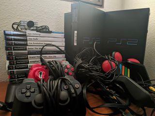 Ps2 + juegos + mandos + accesorios.