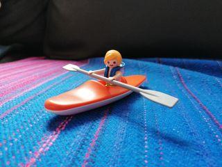 Playmobil niño en canoa