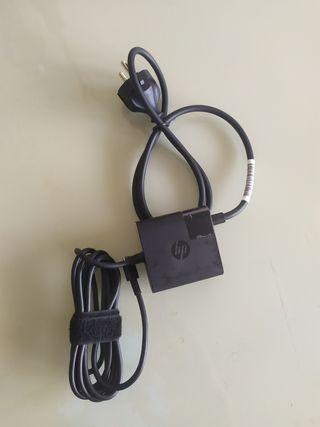 cargador adaptador HP. sin usar