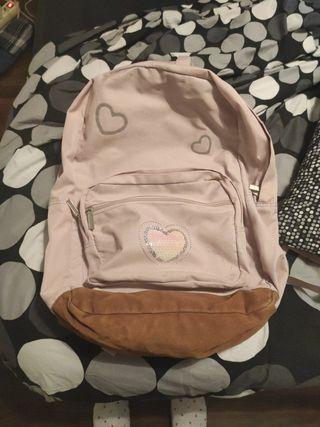 mochila escolar con chubasquero