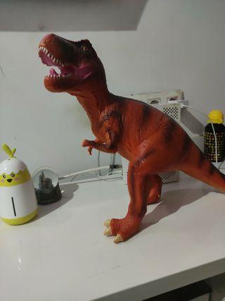 dinosaurio de juguete que hace ruido