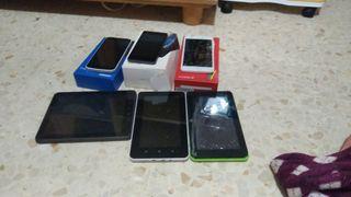 tres tablet y tres moviles con cajas