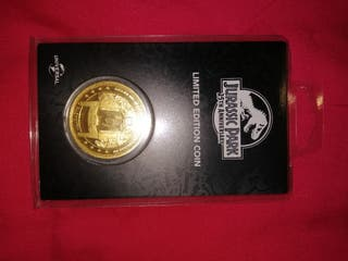 moneda gate jurassic Park oro