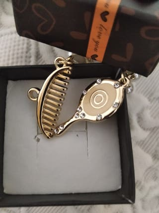 Colgante Peine y Espejo mod Chanel. dorado
