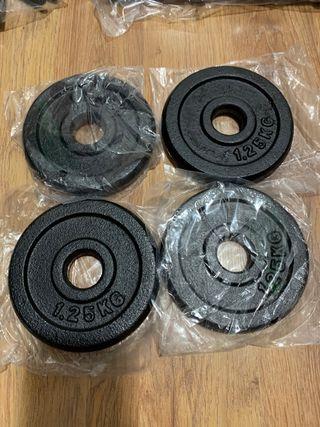 4 discos 1,25kg cada uno,para barras y mancuernas