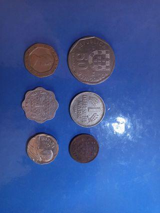 Lote varias monedas extranjeras antiguas.