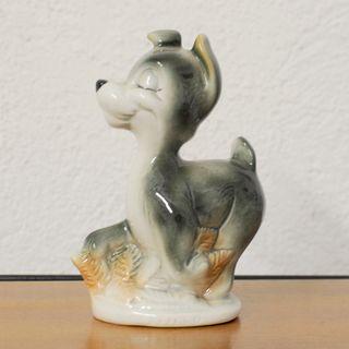 perro disney de porcelana
