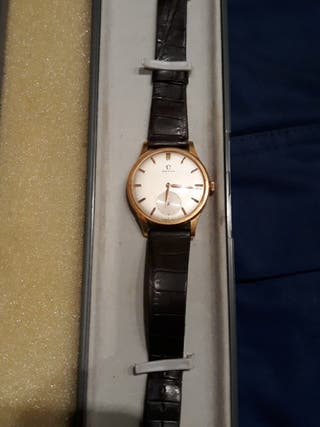 Antiguo Omega oro