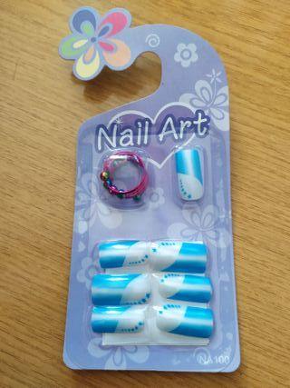 Uñas postizas con adhesivo y anillo incluido. 6