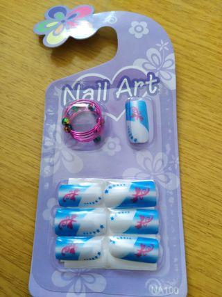 Uñas postizas con adhesivo y anillo incluido. 5