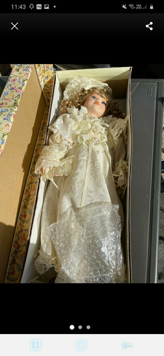 3 Immaculate condition porcelain dolls