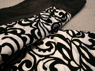 Luxurious black and gold matching throw and pillow