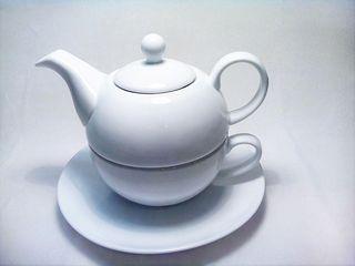 Tetera ceramica con plato y taza
