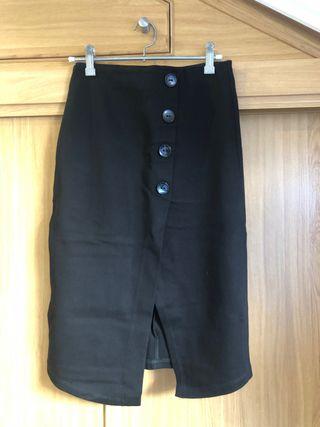 Falda tubo negra elástica Stradivarius S