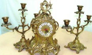 Reloj y 2 candelabros