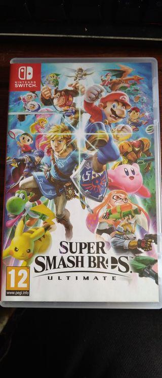 super Smash Bros ultimate y caja metálica