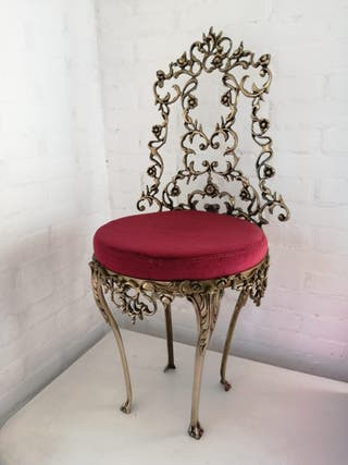 Antigua silla de bronce estilo rococó