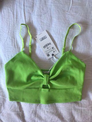 Top verde fosforito de Zara, talla M