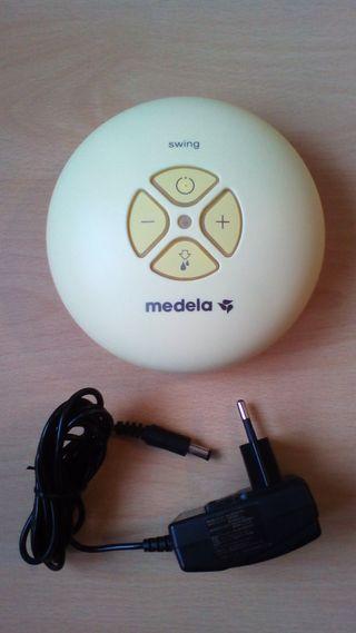 Medela. Motor y Adaptador