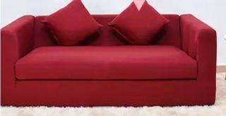 Funda de sofá para dos plazas de color rojo