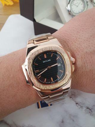 reloj unisex color oro rosa con caja y pulsera