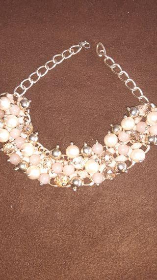 collar de perlas dorado