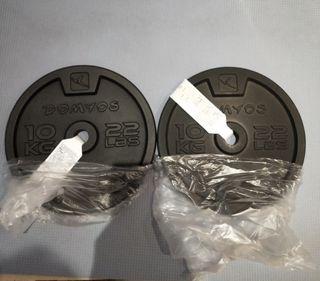 dos discos de 10 kg nuevos