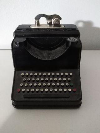 Mechero antiguo máquina escribir.