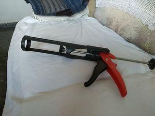 pistola para adhesivo