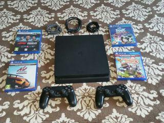 PS4 Play Station 4Slim de 1 TB 2 Mandos y 4 juegos