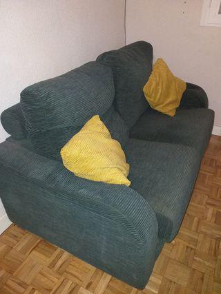 Sofa de dos plazas en pana de color verde