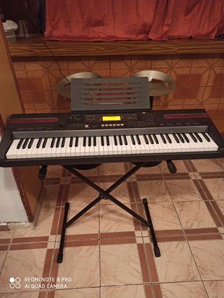 Piano Casio + Soporte