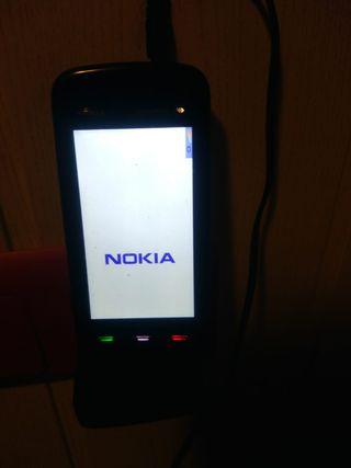Movil antiguo Nokia XpressMusic cargador auricular