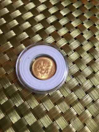 Moneda oro mexicana.