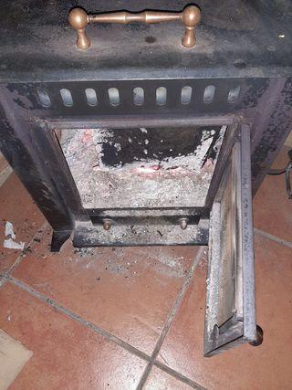 estufa de leña de hierro fundido,refractaria.