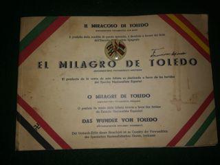 Antiguo libro- El Milagro de Toledo e insignia