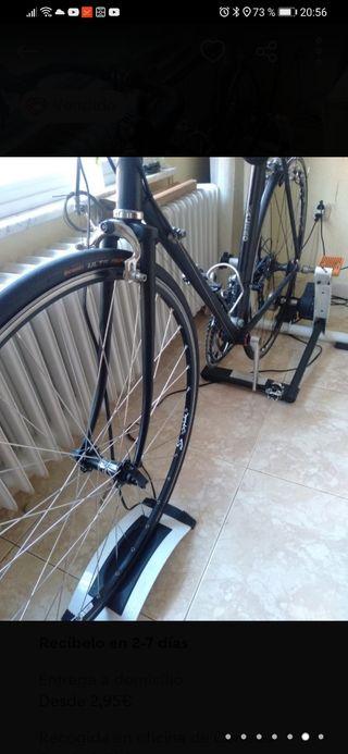 rodillo tack con 7 niveles y bicicleta carretera