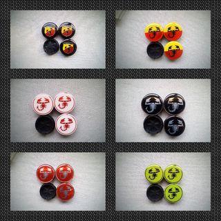 4 Tapabujes centro de ruedas emblema Abarth 49mm.