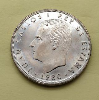 100 pesetas.