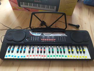 teclado piano electrónico infantil.