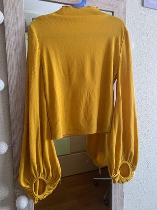 Camiseta tejida de canalé de cuello alto