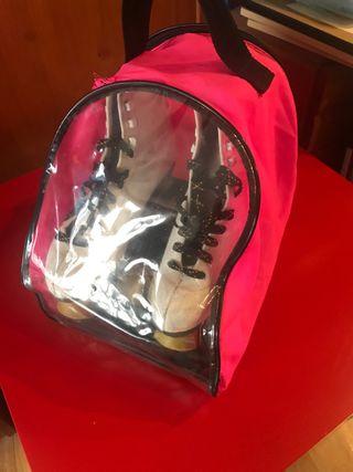 Patines de 4 ruedas en su bolsa